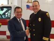 Norman Dascher, CEO of Samaritan Hospital and St. Mary's Hospital, stands with Forest Weyen, executive director of the Bennington Rescue Squad, at a ceremony on May 22 to celebrate the squad receiving a Mission Lifeline Gold Award from the American Hearty Association.