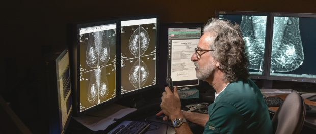 Dr. Andrew Warheit examines a medical image at the St. Peter's Hospital Breast Center in Albany, New York.
