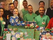 The SPHP Clinical Engineering team's contributions led to a donation of more than $500, which included many wrapped gifts as well as a $100 check, for the adopted family.
